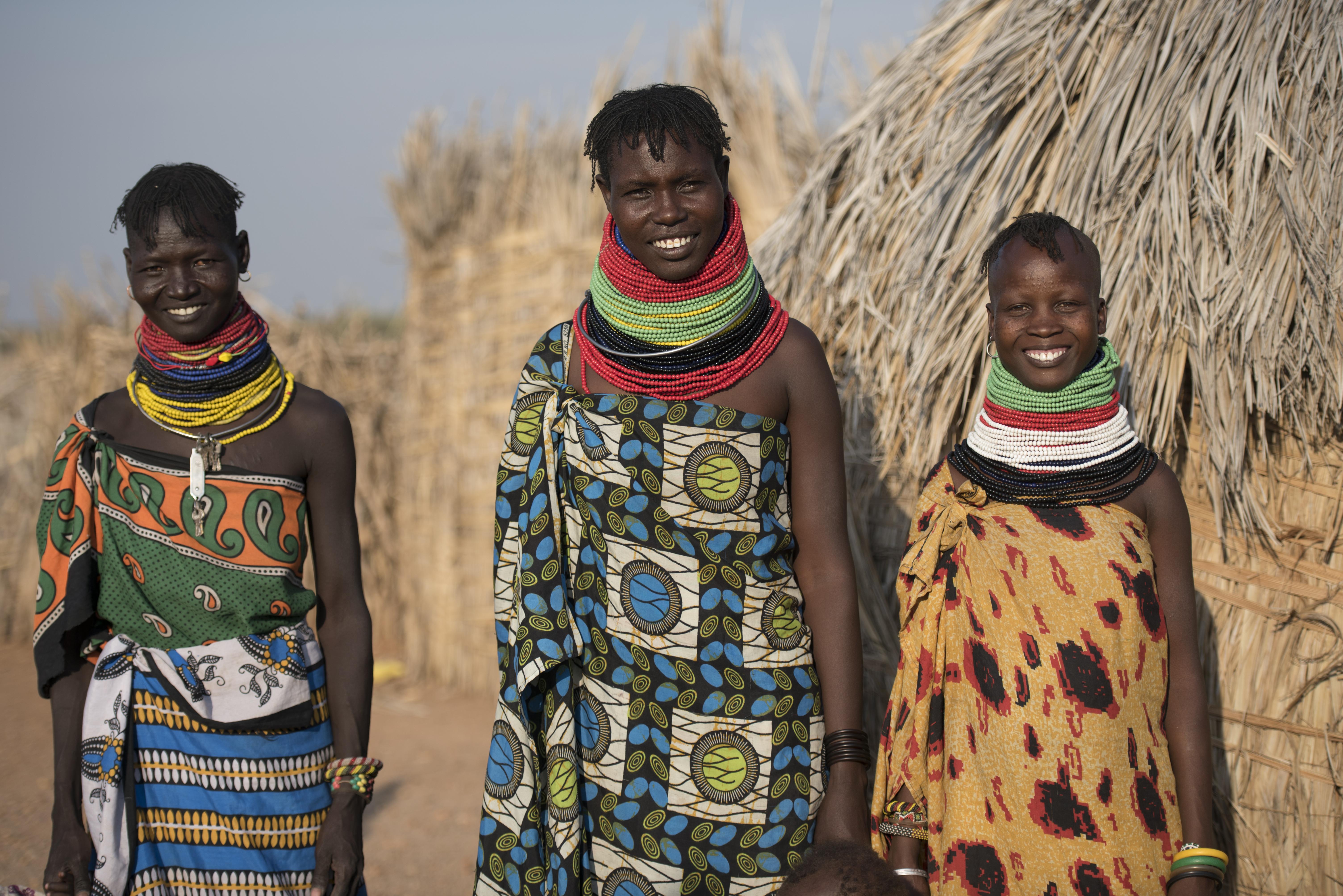 Photo of three women in their village in the Turkana region of Northwestern Kenya