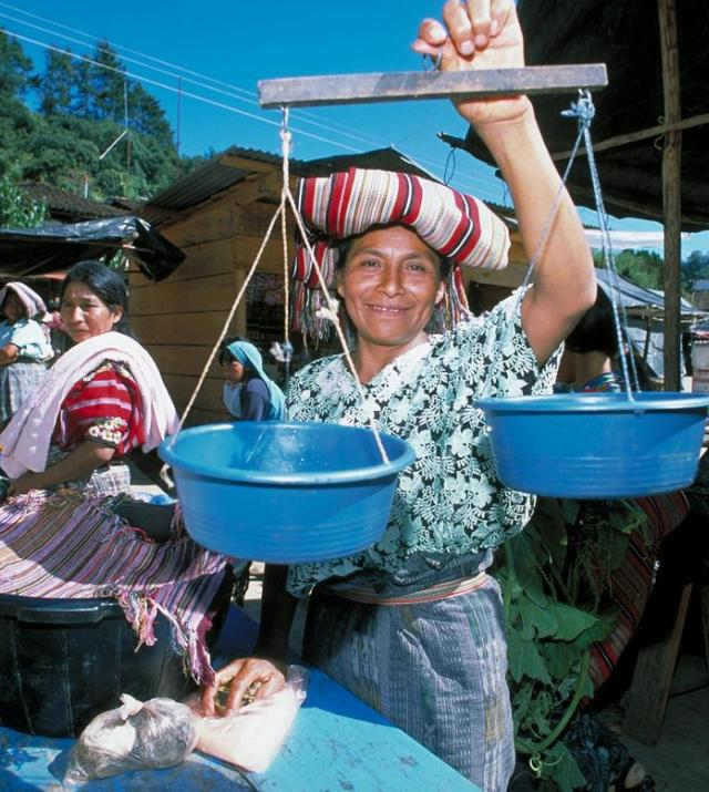 photo of woman smiling at a market