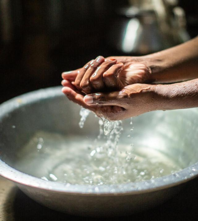 photo of woman washing her hands