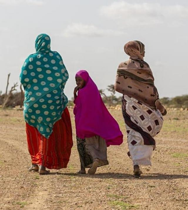 photo of women walking