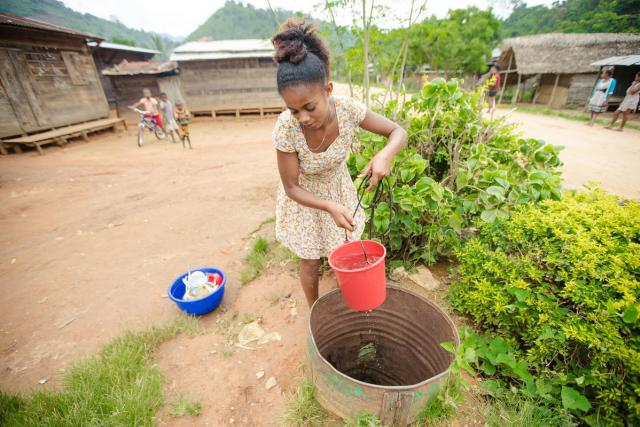 photo of child fetching water